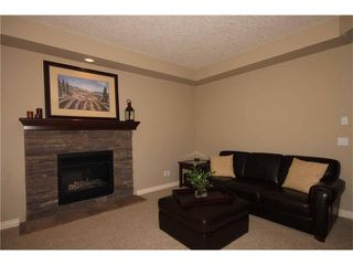 Photo 12: 136 Sunset Close: Cochrane House for sale : MLS®# C4044517