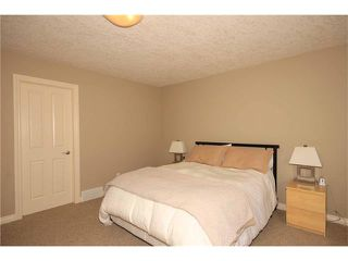 Photo 36: 136 Sunset Close: Cochrane House for sale : MLS®# C4044517