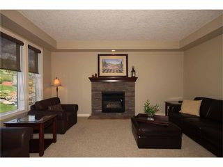 Photo 11: 136 Sunset Close: Cochrane House for sale : MLS®# C4044517