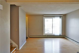 Photo 9: 3 3820 PARKHILL Place SW in Calgary: Parkhill House for sale : MLS®# C4145732