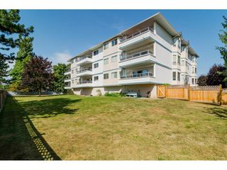 "Photo 2: 205 5377 201A Street in Langley: Langley City Condo for sale in ""Red Maple Place"" : MLS®# R2243839"