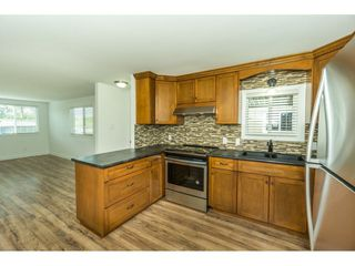 """Photo 2: 14 24330 FRASER Highway in Langley: Otter District Manufactured Home for sale in """"LANGLEY GROVE ESTATES"""" : MLS®# R2263420"""