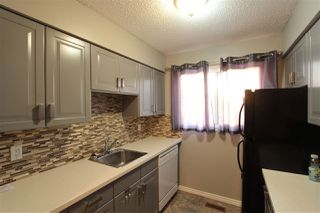 Photo 3: 5803 Riverbend Road in Edmonton: Zone 14 Townhouse for sale : MLS®# E4148541