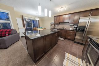Photo 11: 1052 WINDSONG Drive SW: Airdrie Detached for sale : MLS®# C4238764