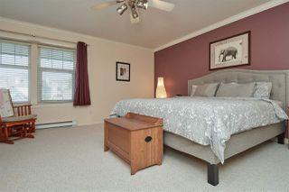 "Photo 13: 52 15037 58 Avenue in Surrey: Sullivan Station Townhouse for sale in ""WoodBridge"" : MLS®# R2377088"
