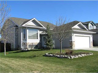 Photo 1: 68 WEST TERRACE Drive: Cochrane Residential Detached Single Family for sale : MLS®# C3463661