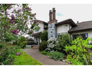 Photo 2: 8151 145B Street in Surrey: Bear Creek Green Timbers House for sale : MLS®# F1439980