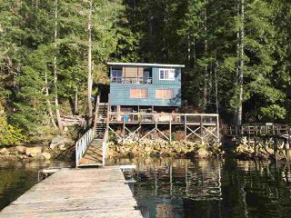 Photo 1: 7711 TUWANEK Trail in Sechelt: Sechelt District House for sale (Sunshine Coast)  : MLS®# R2137669