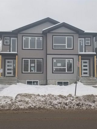 Main Photo: 9323 CONNORS Road in Edmonton: Zone 18 House Half Duplex for sale : MLS®# E4137461