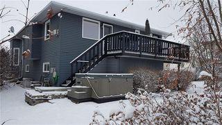 Photo 35: 33 RIVERVIEW CL: Cochrane Detached for sale : MLS®# C4281485