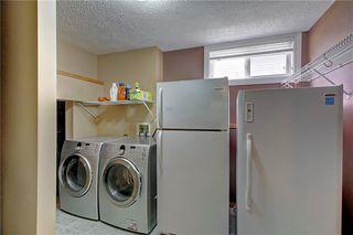Photo 25: 33 RIVERVIEW CL: Cochrane Detached for sale : MLS®# C4281485