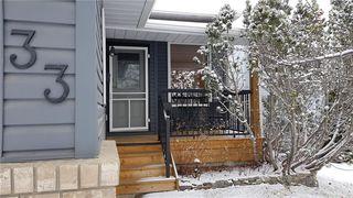 Photo 32: 33 RIVERVIEW CL: Cochrane Detached for sale : MLS®# C4281485