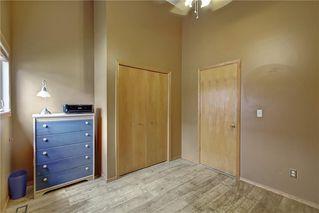 Photo 20: 33 RIVERVIEW CL: Cochrane Detached for sale : MLS®# C4281485