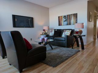 Photo 3: 1212 200 BROOKPARK Drive SW in Calgary: Braeside_Braesde Est Townhouse for sale : MLS®# C3643663