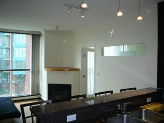 Photo 3: 202 928 Richards St in The Savoy: Downtown Home for sale ()