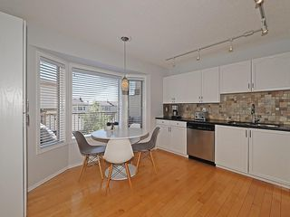Photo 8: 8 PATINA Park SW in Calgary: Patterson Row/Townhouse for sale : MLS®# C4186745