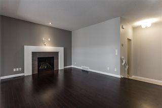 Photo 10: 41 SUNDOWN Grove: Cochrane Detached for sale : MLS®# C4223528