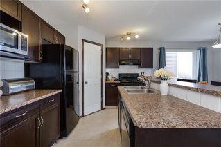 Photo 6: 146 AUTUMN Green SE in Calgary: Auburn Bay Semi Detached for sale : MLS®# C4232262