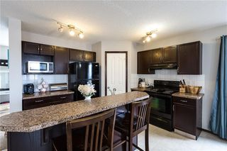 Photo 3: 146 AUTUMN Green SE in Calgary: Auburn Bay Semi Detached for sale : MLS®# C4232262