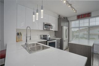 """Photo 1: 13 18681 68 Avenue in Surrey: Clayton Townhouse for sale in """"Creekside"""" (Cloverdale)  : MLS®# R2383969"""