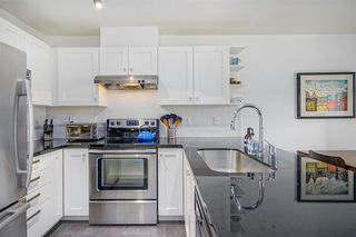 """Photo 1: 211 738 E 29TH Avenue in Vancouver: Fraser VE Condo for sale in """"CENTURY"""" (Vancouver East)  : MLS®# R2399578"""