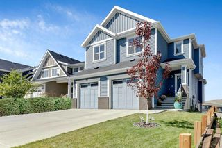 Photo 1: 744 RIVER HEIGHTS Crescent: Cochrane Semi Detached for sale : MLS®# A1026785