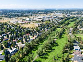 Photo 10: 439 WILDERNESS Drive SE in Calgary: Willow Park Detached for sale : MLS®# A1026738