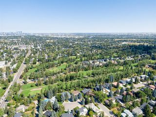 Photo 8: 439 WILDERNESS Drive SE in Calgary: Willow Park Detached for sale : MLS®# A1026738