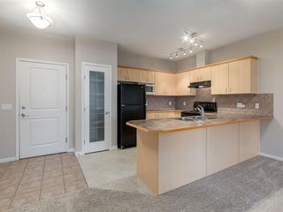 Photo 3: 205 3651 Marda Link SW in Calgary: Garrison Woods Apartment for sale : MLS®# A1053396