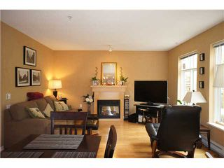 """Photo 1: 71 7488 SOUTHWYNDE Avenue in Burnaby: South Slope Townhouse for sale in """"LEDGESTONE 1"""" (Burnaby South)  : MLS®# V1059651"""