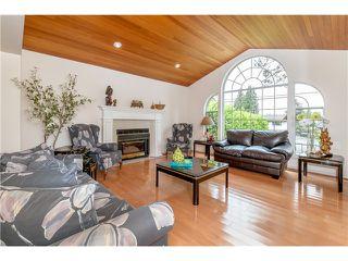 Photo 4: 7340 BURRIS Street in Burnaby: Upper Deer Lake House for sale (Burnaby South)  : MLS®# V1068415