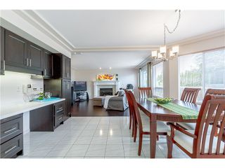 Photo 7: 7340 BURRIS Street in Burnaby: Upper Deer Lake House for sale (Burnaby South)  : MLS®# V1068415