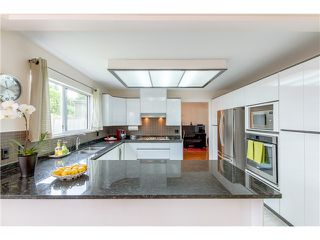 Photo 8: 7340 BURRIS Street in Burnaby: Upper Deer Lake House for sale (Burnaby South)  : MLS®# V1068415