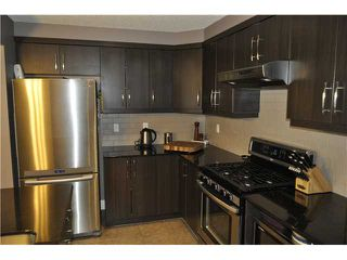 Photo 13: 7 WINDSTONE Green SW: Airdrie Residential Attached for sale : MLS®# C3638273