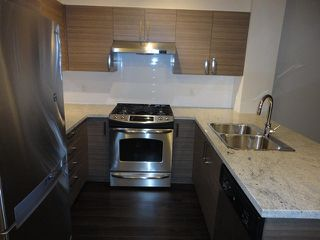 "Photo 6: 417 1153 KENSAL Place in Coquitlam: New Horizons Condo for sale in ""ROYCROFT"" : MLS®# V1109845"