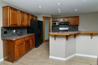 Photo 5: 151 SADDLECREST Gardens NE in Calgary: Saddle Ridge House for sale : MLS®# C4138096