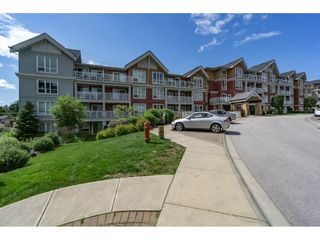 "Photo 1: 305 6450 194 Street in Surrey: Clayton Condo for sale in ""Waterstone"" (Cloverdale)  : MLS®# R2220895"