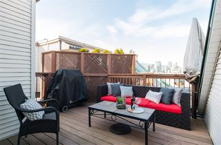 "Photo 1: 305 910 W 8TH Avenue in Vancouver: Fairview VW Condo for sale in ""THE RHAPSODY"" (Vancouver West)  : MLS®# R2249132"