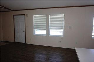 Photo 3: 600 1101 84 Street NE in Calgary: Abbeydale Single Wide for sale : MLS®# C4195525