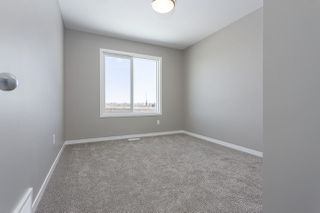 Photo 10: 699 Eagleson Crescent in Edmonton: Zone 57 House Half Duplex for sale : MLS®# E4193980