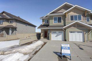 Photo 2: 699 Eagleson Crescent in Edmonton: Zone 57 House Half Duplex for sale : MLS®# E4193980
