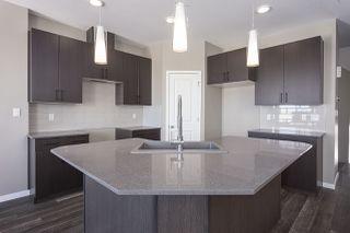 Photo 3: 699 Eagleson Crescent in Edmonton: Zone 57 House Half Duplex for sale : MLS®# E4193980