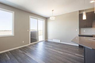Photo 5: 699 Eagleson Crescent in Edmonton: Zone 57 House Half Duplex for sale : MLS®# E4193980