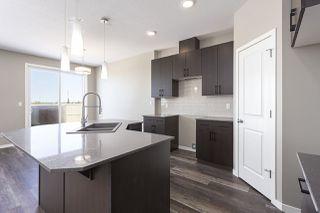 Photo 4: 699 Eagleson Crescent in Edmonton: Zone 57 House Half Duplex for sale : MLS®# E4193980