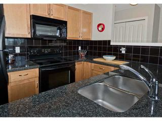 Photo 4: 5 108 VILLAGE Heights SW in CALGARY: Prominence Patterson Condo for sale (Calgary)  : MLS®# C3486250