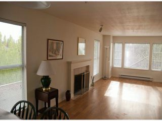 """Photo 1: 202 20350 54TH Avenue in Langley: Langley City Condo for sale in """"COVENTRY GATE"""" : MLS®# F1409886"""