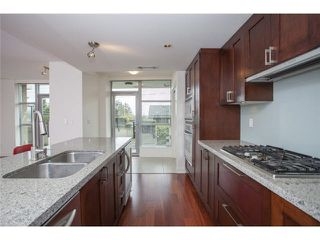 "Photo 5: 104 3595 W 18TH Avenue in Vancouver: Dunbar Townhouse for sale in ""DUKE ON DUNBAR"" (Vancouver West)  : MLS®# V1123567"