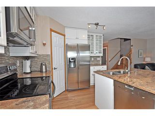 Photo 11: 39 ARBOUR BUTTE Way NW in Calgary: Arbour Lake House for sale : MLS®# C4019158