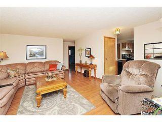 Photo 7: 12 MCKERNAN Court SE in Calgary: McKenzie Lake House for sale : MLS®# C4039610