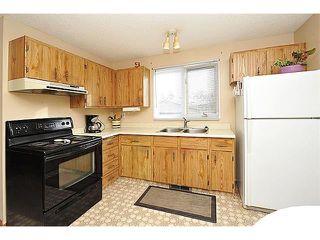 Photo 11: 12 MCKERNAN Court SE in Calgary: McKenzie Lake House for sale : MLS®# C4039610